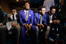 NBA basketball draft prospects, from left, D'Angelo Russell, Justice Winslow, Tyus Jones and Jahlil Okafor wait for the start of the draft lottery Tuesday, May 19, 2015, in New York. (AP Photo/Julie Jacobson)